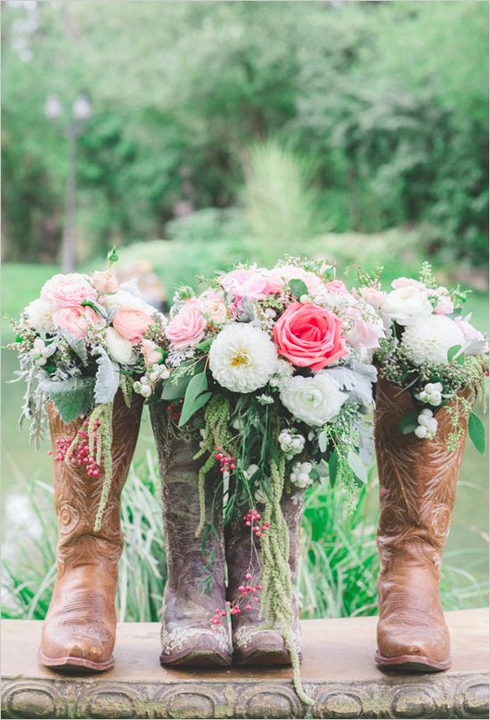 Dainty bouquets in rugged boots. Captured By: Park Road Photography --- http://www.weddingchicks.com/2014/05/08/shabby-chic-western-wedding/