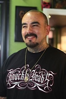 "P.ink Day ""artists we love"" series, #9 of 37: LUIS MARTINEZ  Luis is at Knucklehead Tattoo in Redlands, CA, which also hosted P.ink Day.  He created a spectacular cherry blossom mastectomy tattoo for survivor Maria. ""No words can explain how I felt at the end of the day to see a woman have all her love and beauty back...I was speechless. It took my breath away.""  Hire the man: http://www.Instagram.com/knuckleheadtattoo / Knuckleheadtatto@gmail.com  Photo by Shelley Scarborough."