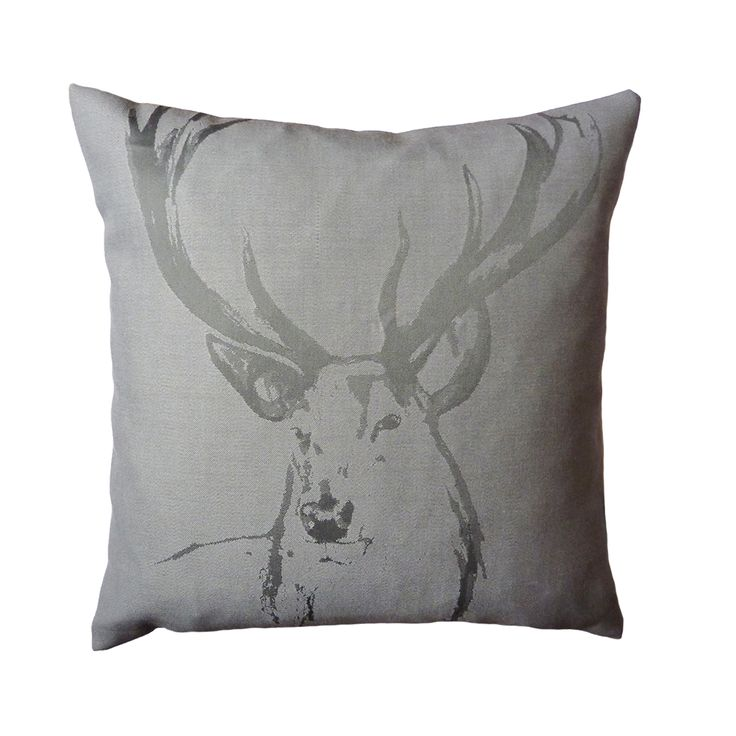 The artistic sketch of Iona Crawford's stag head has been placed on a reversible and minimalistic cushion. The luxury cotton weaves in alternating direction to create subtle texture and shimmer, where both sides adorn the Stag print in grey and cream.  440mm x 440mm  100% cotton twill front and reverse.  Concealed zip closure.  Duck feather cushion pad.  Signature dust bag included.  Made in the UK.