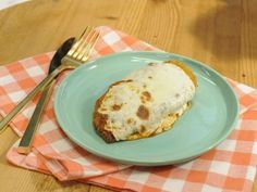 Get this all-star, easy-to-follow Sunny's Easy Chicken Parmesan recipe from Sunny Anderson