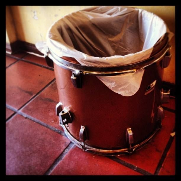 Turn an old drum into a cool bin for trash or recycling!