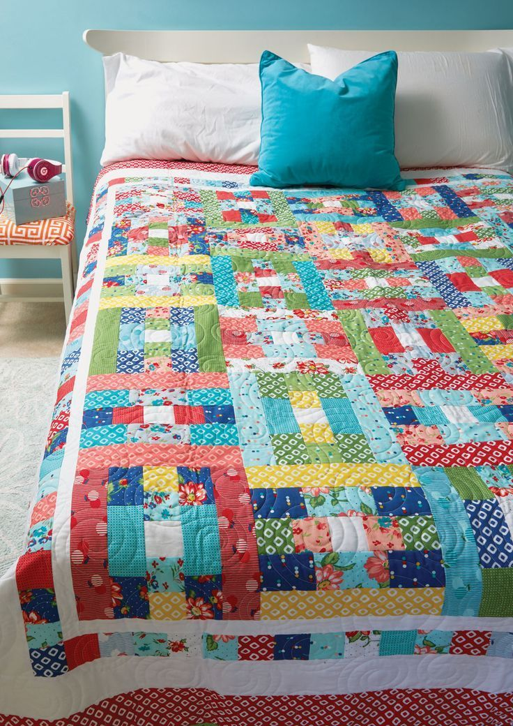 """SASSY DIXIE by Ebony Love: Strip-pieced floral fabrics bring this cute spring-like bed-size quilt pattern to life. Spring quilts are so refreshing! The white inner borders set off the pattern within and showcase its movement. This project also is a great use for pre-cut 2½"""" fabric strips. Get those pre-cuts ready!"""