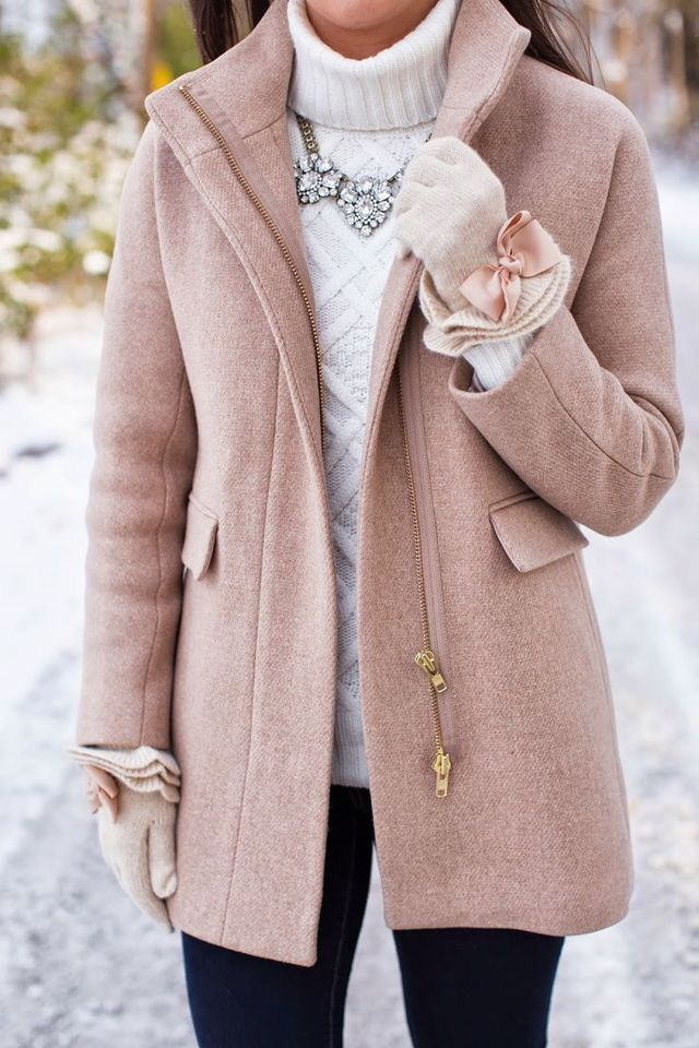 Pale beige/pink coat with white folded turtle neck sweater, ruffled mittens with bows and a necklace