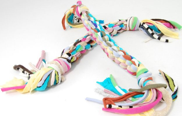 Make a dog toy from braided t-shirts.   26 DIYs Your Pet Will Totally Appreciate