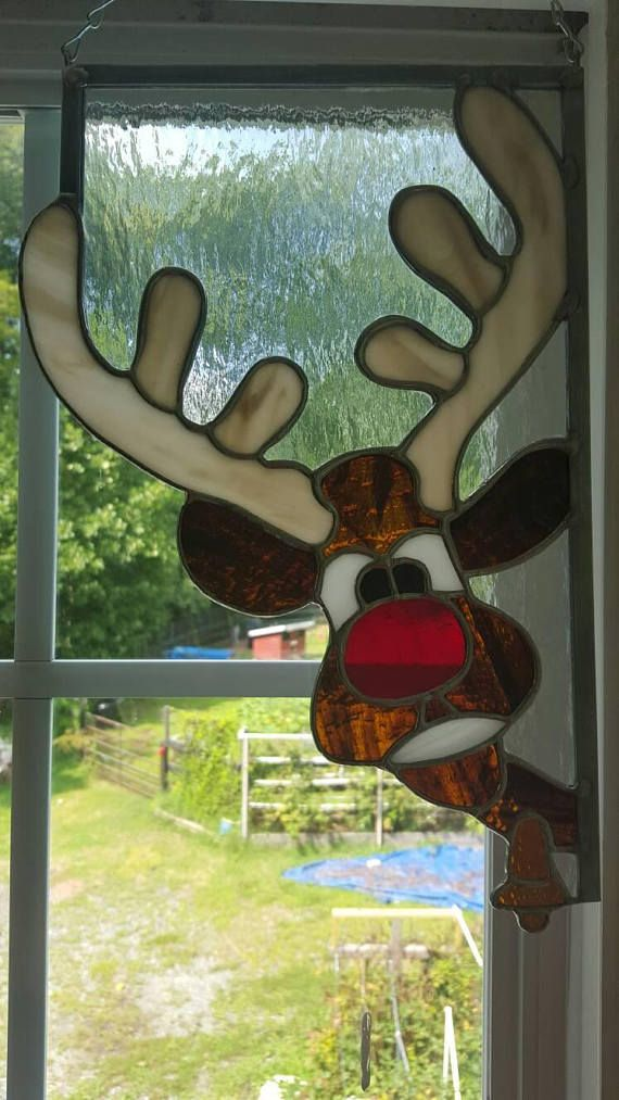 This is a set of a Santa and Rudolph the Red Nosed Reindeer Stained Glass window corners! These are **MY** design and will brighten up any home for Christmas. Santa has his red hat and bright green eyes. Rudolph has his big red nose and a golden bell around his neck. You can even hang