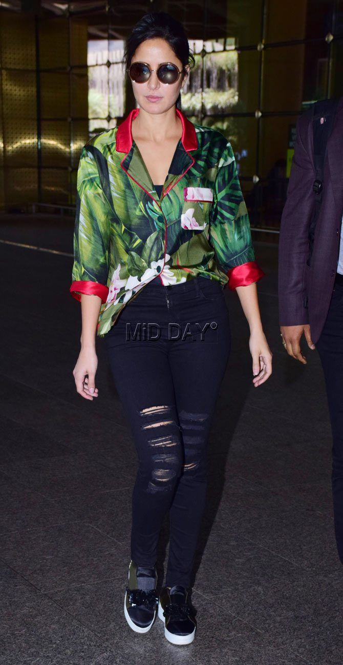 17edbd87fa4 Katrina Kaif Spotted in green and red shirt with distressed black jeans at  the airport!  Katrinakaif  bossbabe  shirt  green  airportlooks  girlswear