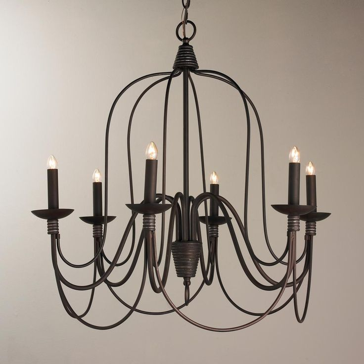 Large Bronze Swag Chandelier With the allure of the French countryside, this oil rubbed bronze chandelier with simple sweeping lines has an open modern appeal. Touches of silver rubbed detailing on the wire wrapped candle arms allows for blending with nickel finishes.