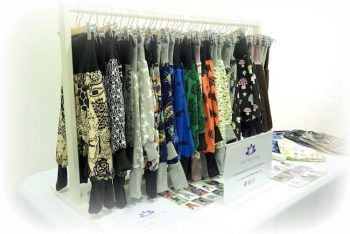 Lotus Baby Design market display of Flexi Harem pants for babies and toddlers.