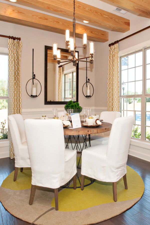 The Dining Room In Our Del Mar Features Medium Hardwood Floors Natural Wood Beams