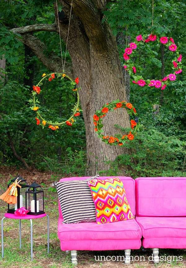 Hung staggered in the trees, a group of hula hoops wrapped in silk flowers makes for a festive photo-op backdrop.