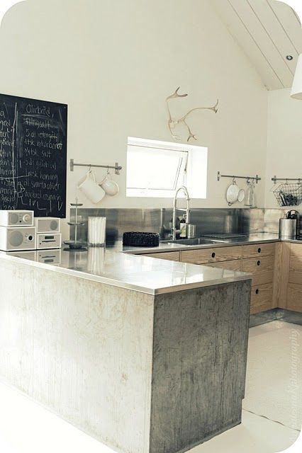 Concrete kitchen lower cabinet frames with wood - Modern rustic contemporary architecture - No upper cabinets - Neutral - Stainless steel countertops and backsplash