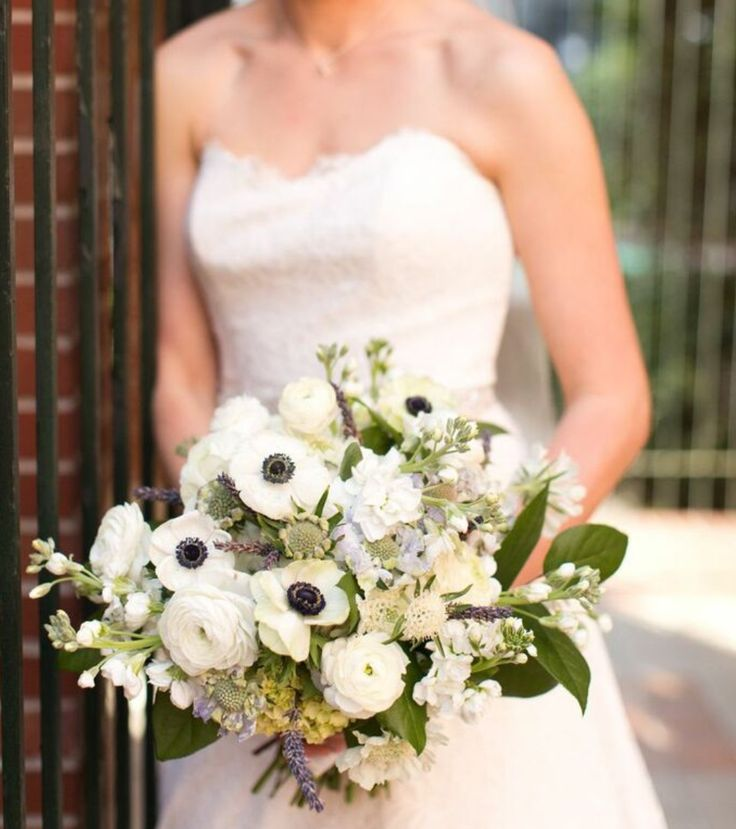 semi structured bridal bouquet of white hydrangea, mini green hydrangea, lavender scabiosa, white stock, white ranunculus, lavender, white scabiosa,white anemone, lavender & lemon leaf wrapped in cream satin ribbon
