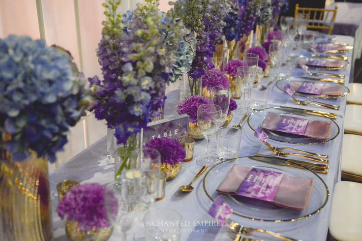 Styled with delicate and beautiful Amethyst hues and gold, the perfect wedding theme to show our teams styling prowess at a recent local Brisbane Wedding Expo. With a soft lilac satin base, this tablescape was adorned with glass gold rim charger plates, gold cutlery with soft gold Tiffany Chairs to carry this elegant theme throughout the space. Wedding Reception Styling Ideas. See the full film on our YouTube channel: youtu.be/rAbfWIOfl_4
