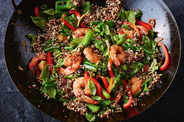 Tri-coloured #quinoa looks great, has a variety of textures and is gluten-free. Try this spicy midweek meal, ready in 30 minutes.