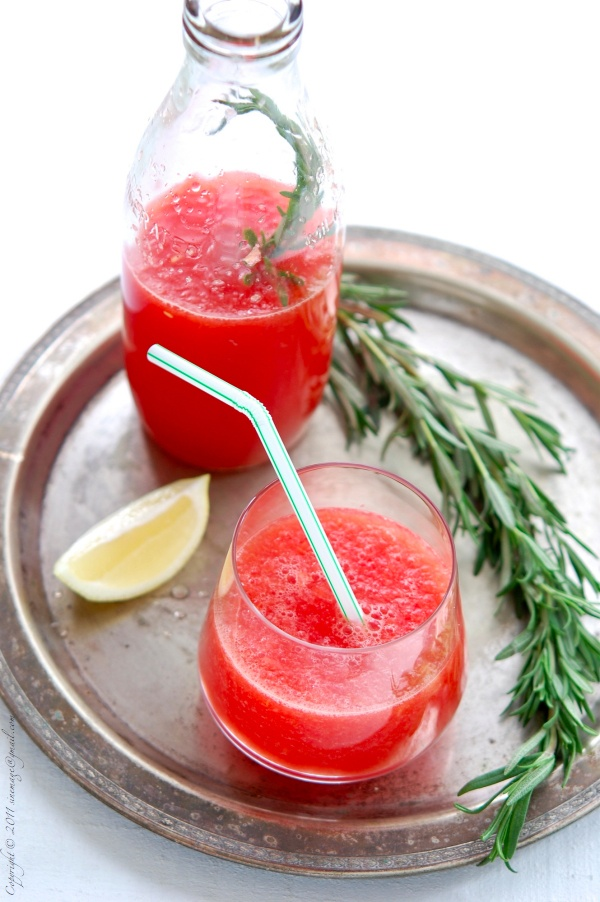 Mix watermelon with ice, lemon juice and flavor with a rosemary sprig.