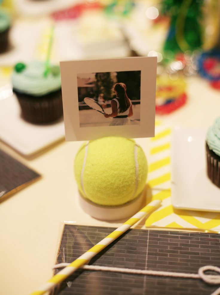 tennis party place card holders with pictures and tennis balls via seejaneblog
