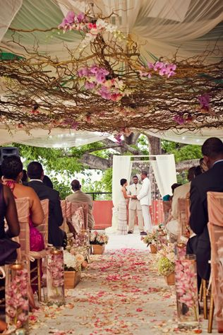 Hands-down one of our favorite ceremony set-ups EVER! This Bahamas destination couple created drama with draping, bright florals and natural vines. // Photo courtesy of La Dolce Vita Studio.