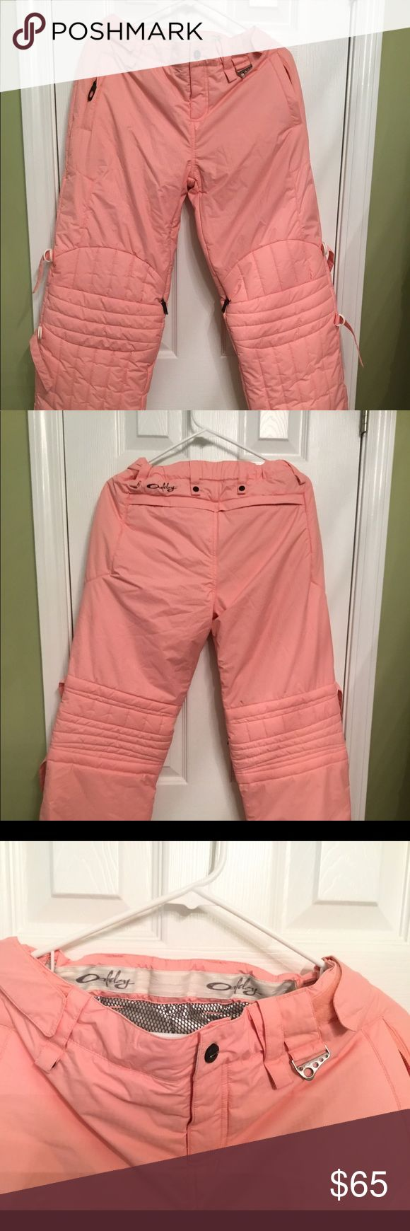 """Oakley Ski snowboarding Pants Nitro Fuel ,Sz small Women's small snow ski paints, Oakley Nitro Fuel 2. Pink/Peach in color. Like new with the exception of one minor grey spot on the back (pic taken of spot). The waist is adjustable, it has Velcro and also belt loops if needed. The waist can be tightened to about 9"""" or loosened to about 15"""" measuring across. Zipper hand pockets on top of each leg to hold money, etc.  Our home is smoke free, I strive for fast shipping, usually within 24 hrs of…"""