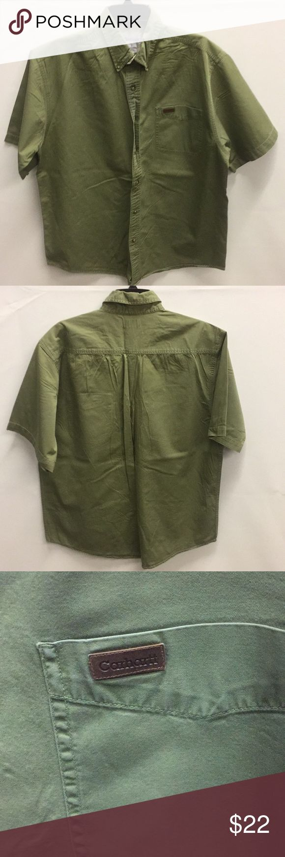 Carhartt Shirt Sleeve Work Shirt. Green with pocket on front with small leather Carhartt logo patch on it. 25In Chest, 33in Long and 26in Sleeves from wrist to shoulder. Shirt is a great for work or casual wear. Carhartt Shirts Casual Button Down Shirts