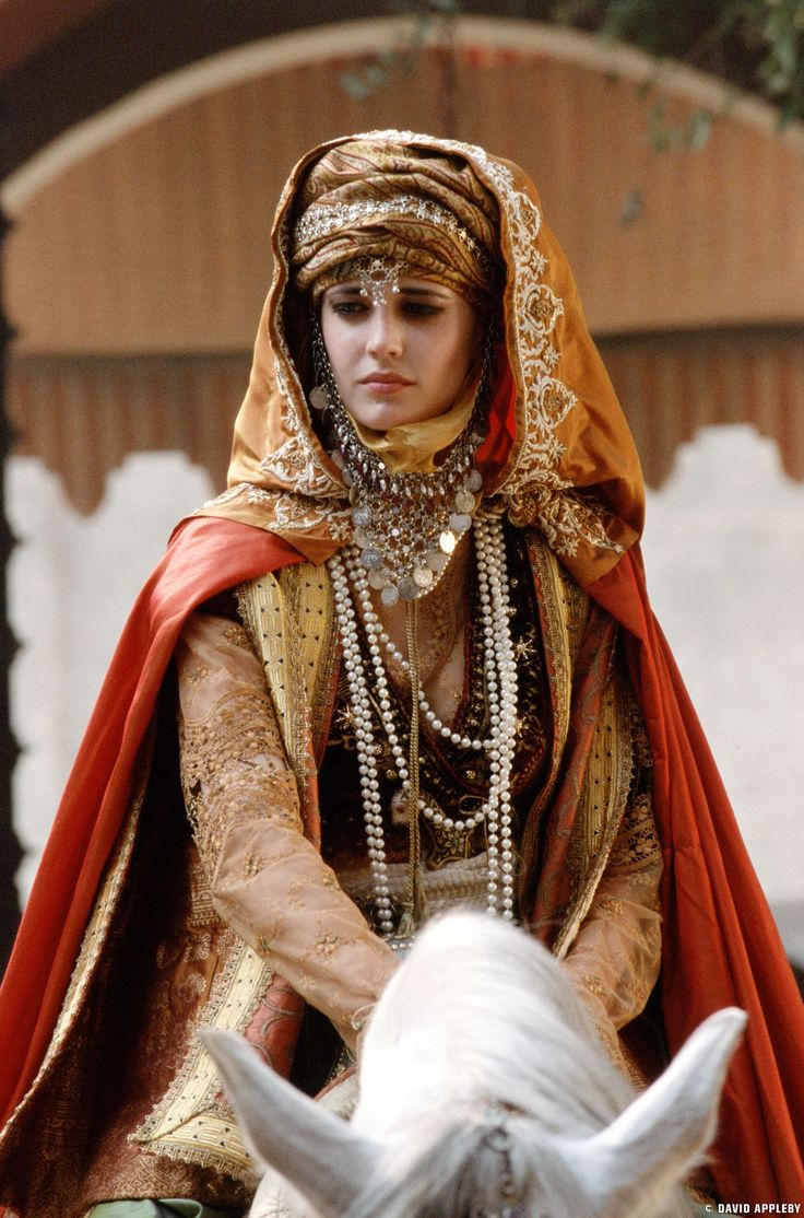 Kingdom of Heaven's costume designer tackled a tough challenge: creating costumes for  aristocrats who had partially assimilated into the culture, but still kept many of their European sensibilities and style cues.  Eva Green's Sibylla is a prime example.  She wears styles indicative of the Holy Land during the time, but with European touches.