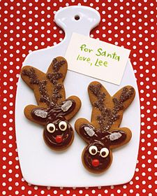 To make a reindeer's head, turn a gingerbread man on his. Add a face, ears, and antlers with melted chocolate chips, sanding sugar, gumdrops, and other candy.