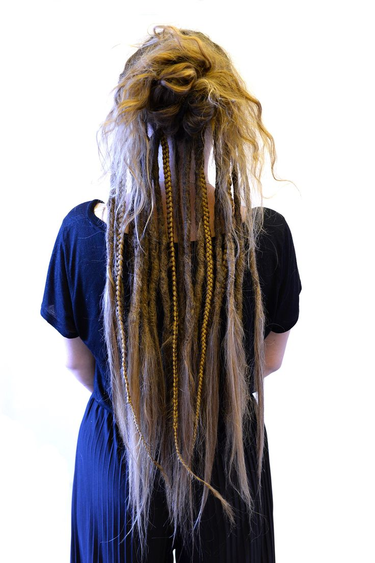 This is Moa she came to me to start her dreadlock Journey. She only wanted partial dreadlocks, to let some of her hair loose and some braids and some loose hair in the ends of her dreadlocks. This is what the end result was when I put her loose hair up.