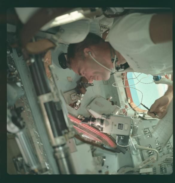 An astronaut aboard the Apollo 7 mission, the first NASA lunar mission. (Project Apollo Archive)