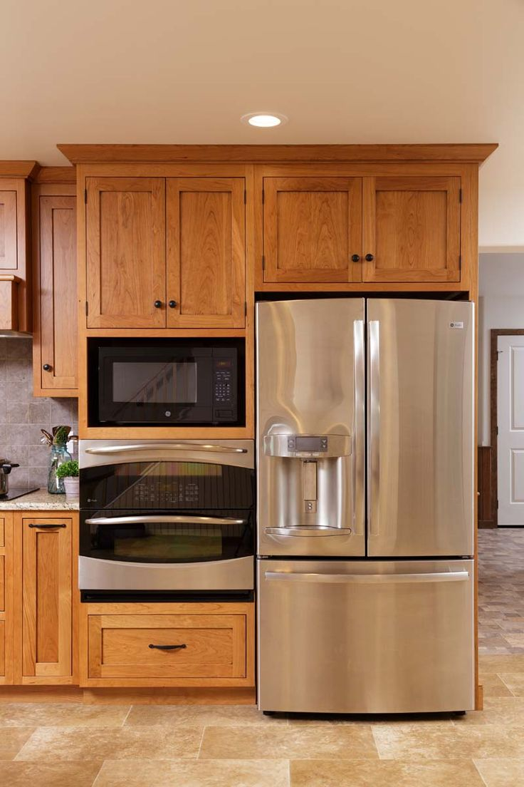 Kitchen cabinets corner oven - A Built In Oven With The Microwave Above