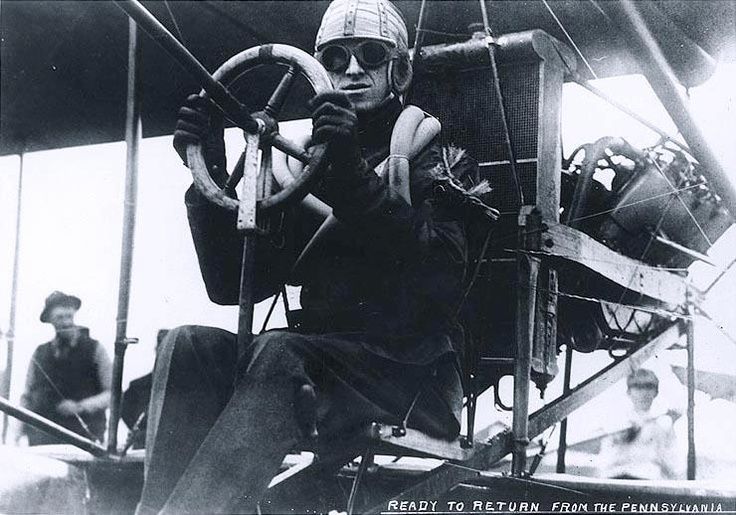 Aviator Eugene B. Ely. Seated in his Curtiss pusher biplane on board USS Pennsylvania (Armored Cruiser # 4), during preparations for his return flight to Tanforan field, San Francisco, California, 18 January 1911.
