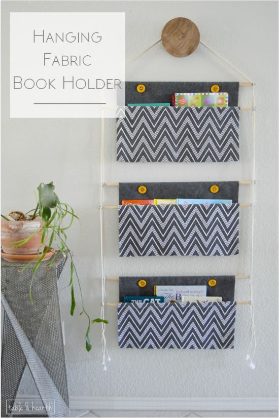 Need a space-saving storage solution for all those books? Check out this hanging fabric book holder!