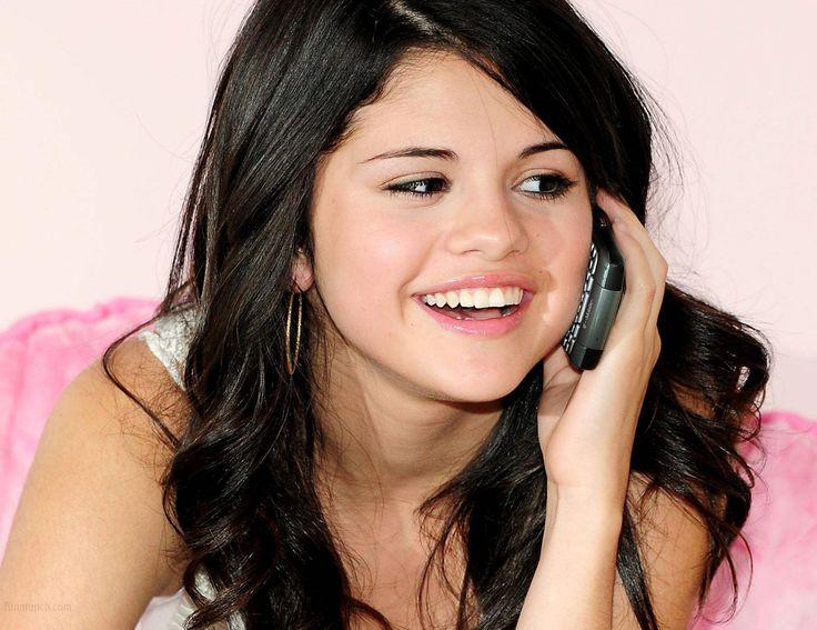 Selena Gomez talking on the phone.
