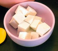 """Just paint small wooden cubes white and add clear glitter paint to create """"sugar cubes"""" for a tea party."""