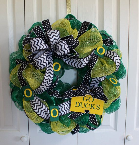 "Custom professional or college sport team deco mesh wreath.  University of Oregon Ducks wreath. ""Go Ducks"" wreath.  Made to order wreath on Etsy, $50.00"