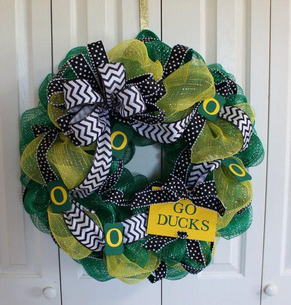 "Custom professional or college sport team deco mesh wreath.  University of Oregon Ducks wreath. ""Go Ducks"" wreath.  Made to order wreath on Etsy, $50.00"