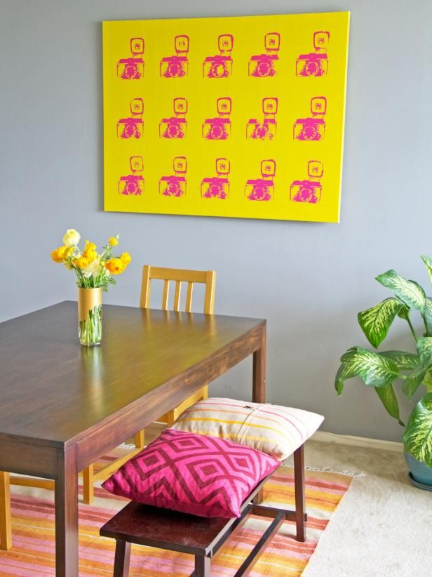 Gray Dining Area With Bright Yellow Wall Art