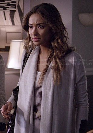 Emily's white graphic tank top and draped cardigan with leather panels on Pretty Little Liars