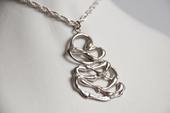 This pendant is hand made and then cast in silver.Unique, no two will ever be the same    Other metals available please enquiry for prices    Random pattern looks like a stream of molten rock just came out of a volcano    Part of the Lava/Molten rock style range    Earrings : https://www.etsy.com/listing/111212610/free-form-molten-rock-lava-style-silver  Ring ; https://www.etsy.com/listing/111211722/free-form-molten-rock-lava-style-silve...