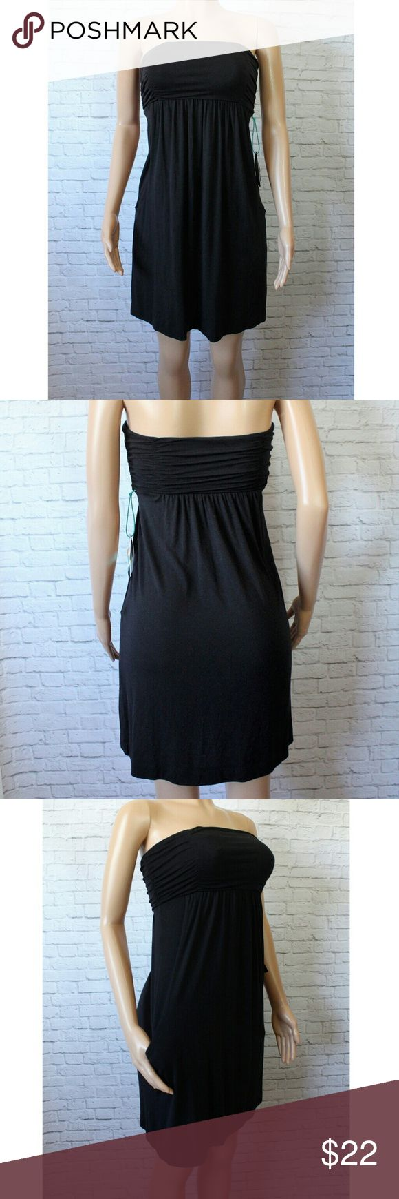 Half Moon Black Cover up Trendy black beach cover up dress. Has a padded bust and pockets. Size Small. NWT Modern Movement Swim Coverups