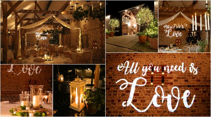 Swagged ceiling drapes with pealights.  Pealights wrapped around shrubs.  'All you need is love' gobo , vintage and storm lanterns at Upwaltham Barns by www.stressfreehire.com #venuetransformers