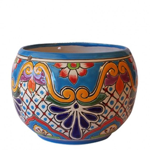 I love the colours in these pots.  They'd be perfect on my window in the kitchen for herbs.    (Beauty Mexican Pottery Design for Garden Accessories, Pots by Anthar Bowl Pot)