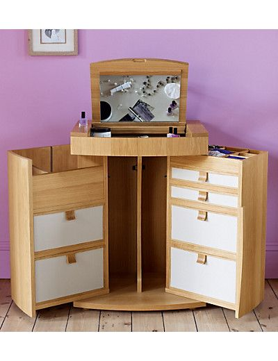 Gainsborough Dressing Table T657097 £999.00 Crafted predominantly from solid oak and oak veneer. This compact dressing table combines style and function. Both doors open fully to reveal 6 drawers with an additional deeper compartment for larger products. The lid lifts to reveal a mirror and storage compartments for all your smaller accessories. Size: H82.0 cm x W66.0 cm x D53.0 cm