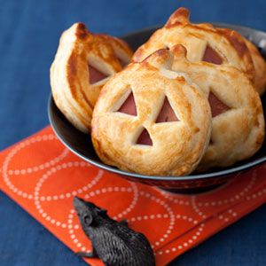 Jack-o-Lantern Sandwich Bites layer ham and cheese between layers of puff pastry and bake at 425 for 12 to 15 minutes