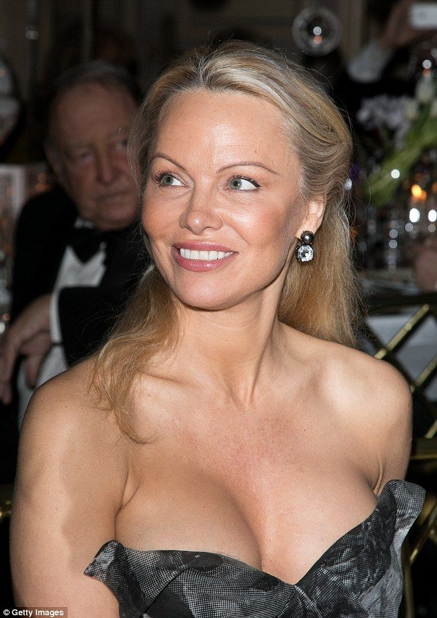 She's eclectic: Pamela Anderson sported a strapless black and grey ensemble as she stepped out at the Best Award Gala 40th Edition' at Four Seasons George V hotel