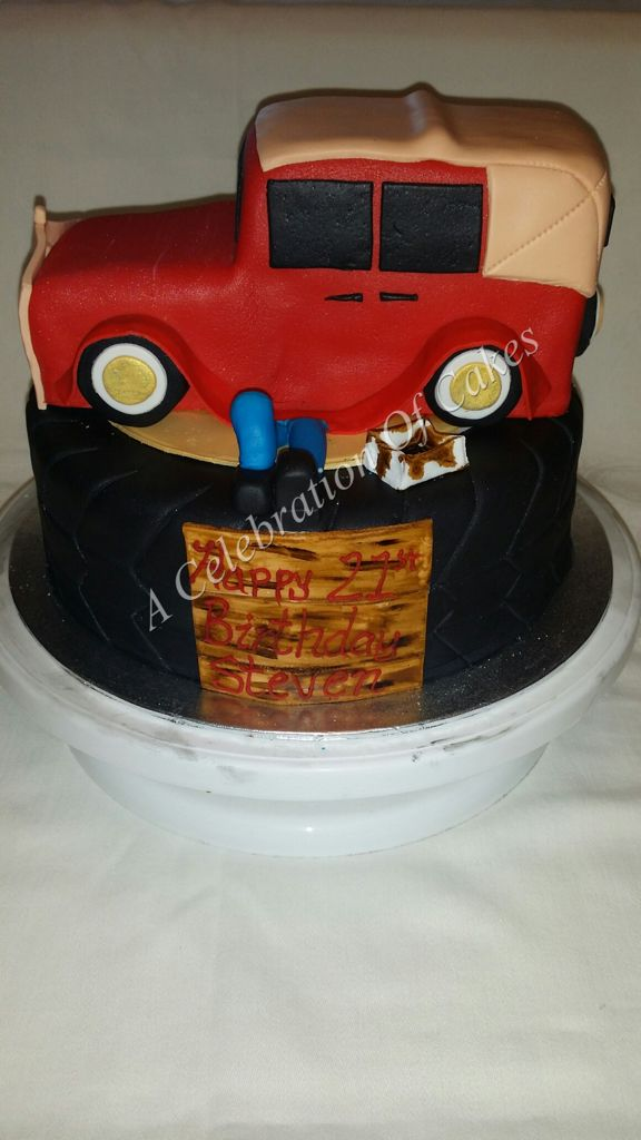 Vintage Car sitting on a tyre cake