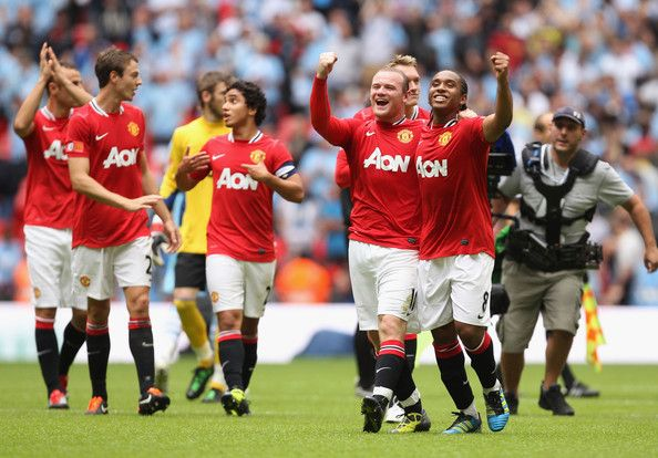 Wayne Rooney and Anderson celebrate winning the 2011 FA Community Shield