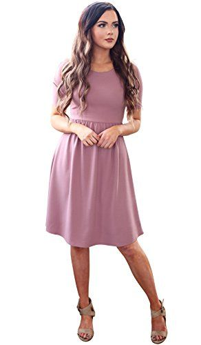 096d1b98c82a The Natalie dress is a comfortable & casual classic style with an amazing  flattering fit! Features include a high rounded neckline, half-sleeves, ...