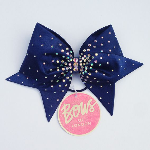 Navy bow with AB crystals and large AB centre crystals. Approx. 25cm from tail to tail.To place an order please send us an email through our contact page to request an order form!