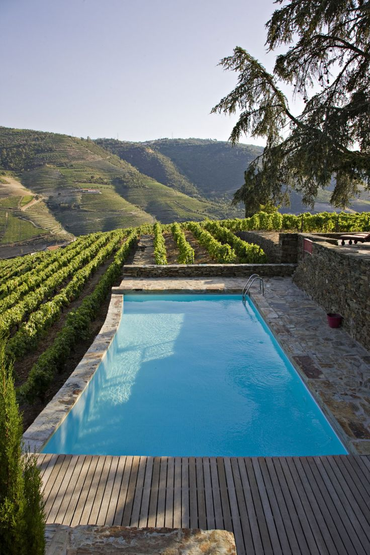 Enoturismo mágico en el Douro portugués.  From loff.it #Portugal pool in vineyard. magnificant views, natural stone terrace light. natural stone curved edge pool