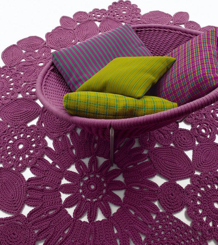 #designbest 's Top10 products by Paola Lenti @paola_lenti | Crochet, Patricia Urquiola, Eliana Gerotto, 2005 | Crochet gets its name from the handicraft which has inspired this piece. In fact, this carpet is crocheted by hand. Designed by Patricia Urquiola, the renowned Spanish designer, who has imagined a carpet with a weave made of flowers and leaves. | #homedecor #purple