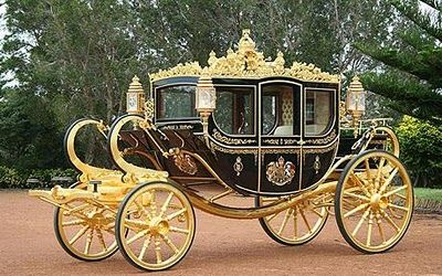 This coach was built for the Queen's 80th birthday.  The passenger doors are inlaid with wood from Henry VIII's flagship (the Mary Rose), the Tower of London and St Paul's Cathedral.  Admiral Nelson's golden crown, rescued from the battle of Trafalgar, rides atop the roof.